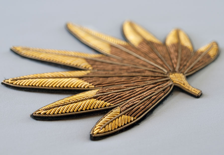 Gold leaf applique hand embroidered metal thread